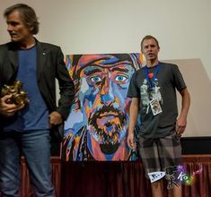 Viggo Mortensen and Christopher Van Redman take a moment to pose next to Christopher's painting of Dennis Lee Hopper. — with Viggo Mortensen's Art, Viggo Mortensen and Chris Redman in Cathedral City, CA. via Artist Perspective-Featuring the Art of Paul W. Koester