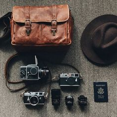 @benjhaisch's. Brixton messenger, Leica + Hassy goodies, hat and passport, what more do you need? // #InMyONA