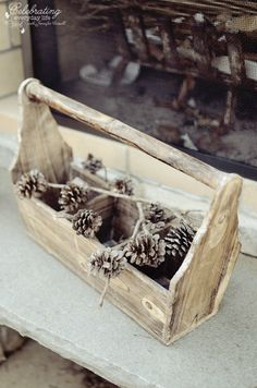 pinecones in wooden tool caddy from my Tally Ho dinner {aka my Ralph Lauren inspired dinner part 2!}