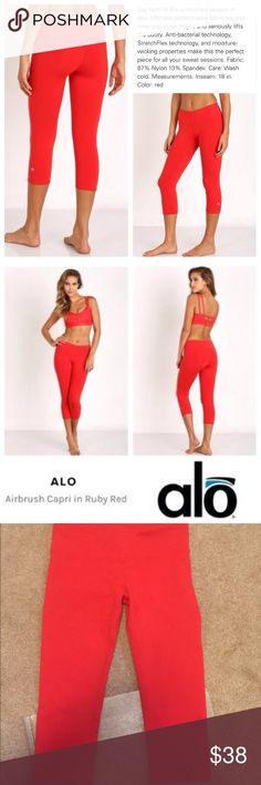 ALO Yoga Capri leggings GUC. Featuring a high-end fabric that will literally 'snap' into place, lifting your booty, smoothing your thighs and flattening your tummy for a fit that's out of this world! These beauties are available in a super flattering shade of 'ruby red', in a moisture-wicking material w/a 4-way stretch that's ideal for workouts, yet so beautiful they'll work perfectly for outside the gym as well! Retail at $68! ALO Yoga Pants Leggings