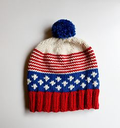 A patriotic hat to be worn year round, the Old Glory Hat is a great sampler pattern that gives you practice with ribbing, fair isle and stripes. Knit with bulky yarn on size US 10 needles, it's a perfect weekend project. Top it off with a firework-style pom pom and you're ready for anything on Fourth of July!