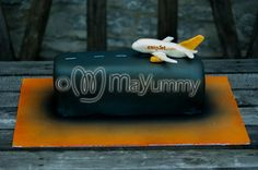 Easy Jet Runway.Vanilla sponge covered in sugarpaste. With an Easy Jet plane topper.