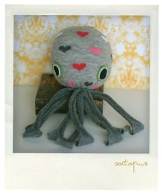Soctopus! Make an octopus with a sock. Take a sock, stuff with fabric or plastic bags. Sew shut. Cut bottom of sock into legs.