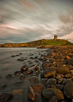 'For a complete contrast to Britain's busy tourist destinations head for the peace and quiet of Northumberland. It wasn't always so tranquil, though, as the legacy of castles in the area shows. Places like Dunstanburgh, Bam Northumberland National Park, Northumberland Coast, Places To Travel, Places To See, Dunstanburgh Castle, Voyage Europe, Kingdom Of Great Britain, Landscape Photos, Beautiful Places