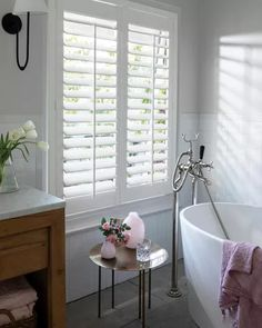 Our Eco-Wood Shutters feature the beauty and architectural value of wood and offer even greater consistency and durability. The perfect shutter for high-moisture, high-traffic settings, our Eco-Wood Shutter is made from wood composite and finished with a Blinds For Bathroom Windows, Shutters With Curtains, Bathroom Window Coverings, Small Bathroom Window, Wooden Window Blinds, White Shutters, Indoor Shutters For Windows, Wooden Shutters Indoor, Window Shutters Inside