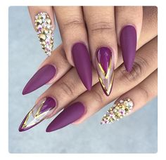 Purple is not always an easy color to pull off. These nails slay me