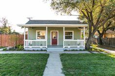 Nassau Ranch Home. Green house with white railings on the porch, neat walkway & lush lawn. #RealEstate #Property #Craftsman #California #Duplex  www.verono.com/nassau
