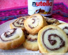 Nutella Pinwheel Cookies!!! These are amazing, and quick to make.  I load mine up with nutella, and cut it with a very sharp knife.  BUt you can also dip them in nutella/chocolate if you can't get enough.