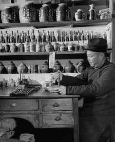 A Chinese herbal doctor at his drugstore. Photograph by Mark Kauffman. Lin Tung, China, May 1947.