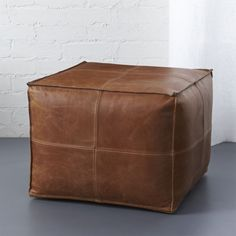Shop leather pouf.   Introduce hide to your habitat via authentic aniline-dyed buffalo leather, revealing natural grain and texture that wears and softens over time.  Hand-stitched quadrants shape up sides with flange edging.