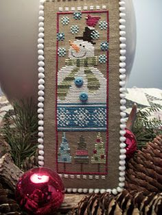 Another cute finishing of cross stitch with a pom pom trim.  I definitely have to do this.
