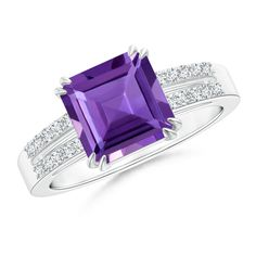 Elegantly designed in 14k white gold, this solitaire ring with diamond shoulders showcases an emerald-cut royal purple amethyst in a double claw prong setting. The diamonds are prong set on the lustrous split shank.