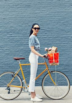 """""""I'm always asked what the perfect outfit for riding a bike is, and I always have the same answer: one that looks good on and off your bicycle. This look is playful and cute, plus the striped top makes me feel like I'm riding my bicycle on the Italian coa Bicycle Women, Bicycle Girl, Gazelle Van Stael, Velo Biking, Velo Vintage, Vintage Bicycles, Cycle Chic, Winter Mode, Bike Style"""