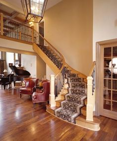 Flared Maple Staircases with Wrought Iron by Great Lakes Stair & Millwork (Stair.com)
