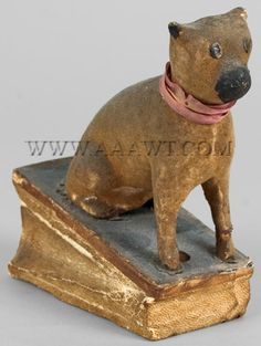 Antique Squeak Toy, Seated Dog with Pink Ribbon, angle view