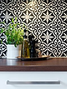 This WILL bey kitchen. I already was going to replace my countertops to these!! Tiles... Love a black and white kitchen with a pop color to accent.