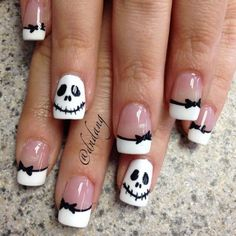 French nails with white tips bows and Halloween ghost faces
