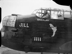 "Flight Lieutenant R A Fletcher in the cockpit of Avro Manchester Mark IA, 'OF-P' ""Sri Gajah"" ""Jill"", of No. 97 Squadron, at RAF Coningsby, Lincolnshire."