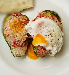 Stuffed Mexican Avocado and Poached Egg - This amazing brunch or breakfast recipe, has a Mexican flareto it with salsa stuffed grilled avocados with a crispy breadcrumbed coating.