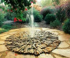 amazing DIY outdoor water fountains with stacked wood for garden flower design with landscaping ideas