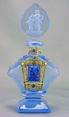 1930s art deco Czech glass perfume bottle.  Beautiful brass filigree and and blue carvings.