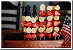 Healthy Red, White, and Blue snacks! Banana, Strawberry, and Blueberry Fruit Skewers are Perfect for Memorial Day