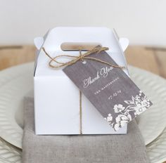 Mini gable box with woodsy personalized favor tag and twine.