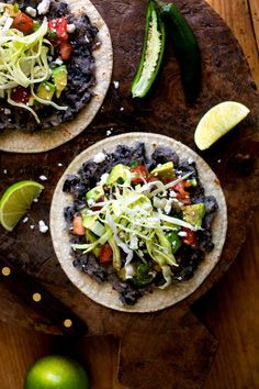 Refried heirloom vaquero beans add a special touch to these tostadas, but black beans work, too. These are not unlike Oaxacan tlayudas, though this recipe doesn't call for that dish's signature extra-large corn tortillas. (Photo: Andrew Scrivani for The New York Times)