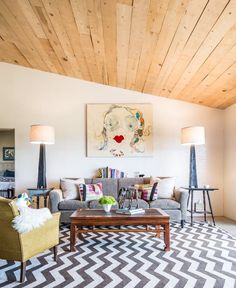 Eclectic living room with wood plank ceiling