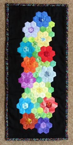 My Hexagon flower mini quilt.                                                                                                                                                                                 More