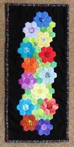My Hexagon flower mini quilt.                                                                                                                                                                                 More
