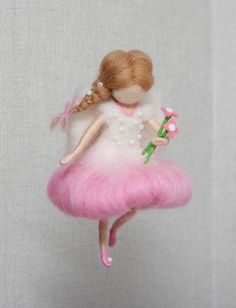 Needle felted Pink fairy is about 5,5 (14 cm) tall. Her dress is decorated with beads. There is a wire in the arms and legs of the wool fairy. So you can gently change the position of her arms and legs. Needle felted fairy mobile is handmade with love from 100% merino wool. This