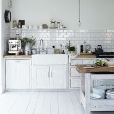 subway tile, open shelving, farmhouse sink, butcher block counters.  basically my dream kitchen!