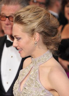 Amanda Seyfried pulled back in the middle with a low bun