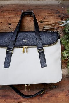 Make it a white Christmas with the #Fossil Preston Tote in bone and black.