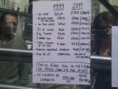 Con el euro nos la metieron... Cartel de un camarero en la puerta del Sol, en Madrid