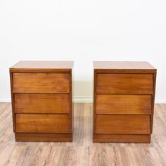 This pair of mid century modern nightstands are featured in a solid wood with a light glossy cherry finish. These end tables are in great condition with 3 large drawers, a slanted front and inset handles. Simple bed side tables with tons of storage! #midcenturymodern #dressers #nightstand #sandiegovintage #vintagefurniture