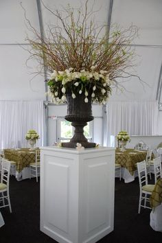 The center of this room featured a large greystone urn with a bursting arrangement of sprouting curly willow branches with a broad collar of whit hydrangea and hundreds of cascading white French tulips. So beautiful.  www.Penncora.com