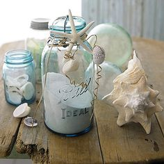 Shells work wonders for plain jars. Fill jars with sand, then wrap raffia or twine around the jar tops. Tuck in starfish and tie on sand dollars, shells, and other various beach items.