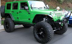 i loveee jeep wranglers 4 doors with a lift and big tires! they look so good!