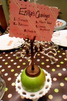 Cute idea for center pieces. Random tidbits about mommy-to-be :). MAYBE even make a game out of it and try and pick the one that is NOT true!!  Or I think it would be neat to give everyone a list of Wive's tales, and clues about how you are feeling, what you are eating, et. cet. could be scattered around room to help them guess! @Nicolette Reed