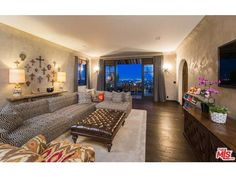 Pin for Later: Peek Inside Megan Fox and Brian Austin Green's Love Lair  A gallery wall of miscellaneous crosses takes the place of art. Source: Coldwell Banker