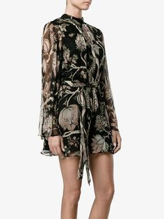 This black and multi-coloured Zimmermann floral print silk playsuit is a trusty…