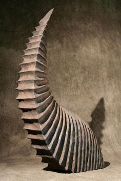 '#080708' (2008) by French sculptor Thierry Martenon (b.1967). Maple, 700 x 900 x 150 mm. via the artist's site