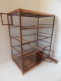 Brand new, unused, handmade wooden bird cage, cage is made from walnut, wire spacing is about 0,4 inch and is painted with linseed oil, 11 rungs plus one with swing, feeder, tray  For price of shipping for other countries please contact me  Size: lenght(left to right) 23,4 inch (60cm) width(depth) 13,6 inch (35cm) height 29,5 inch (75,5cm)