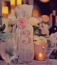 DIY Wedding Centerpieces. Burlap wrapped wine bottles!