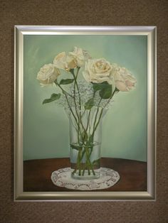 The oil painting of the flowers is very delicate with the crystal and lace doily so we kept it light with a brushed silver frame