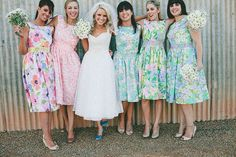 mismatched floral bridesmaids dresses -- love this! // photo by Anna Rose Photography