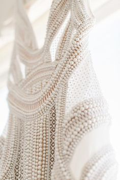 J'Aton gown | Hand beaded with glass pearl and studded ceramic beads on a caged embroidered mesh
