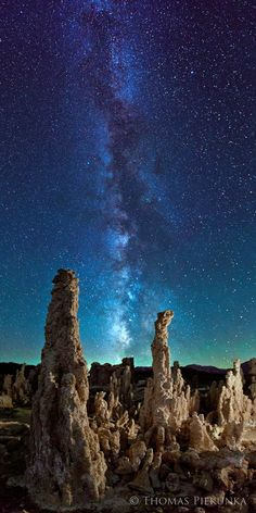 """""""The moon had just set directly where the Milky Way became visible giving the sky a turquoise glow that I have not seen since. These are the tufa towers at Mono Lake on the eastern side of the Sierra Nevada mountains outside of Yosemite National Park. The combination of the Milky Way and these ancient formations gives the image a timeless quality. This is a 2 shot vertical panorama. I wanted the image to be like a slice of time and space, thus, the title."""""""